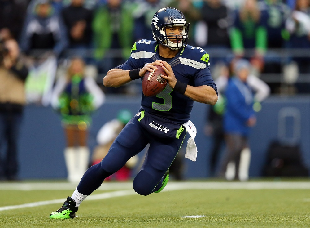 Wilson sticks with Seahawks, becomes highest paid player