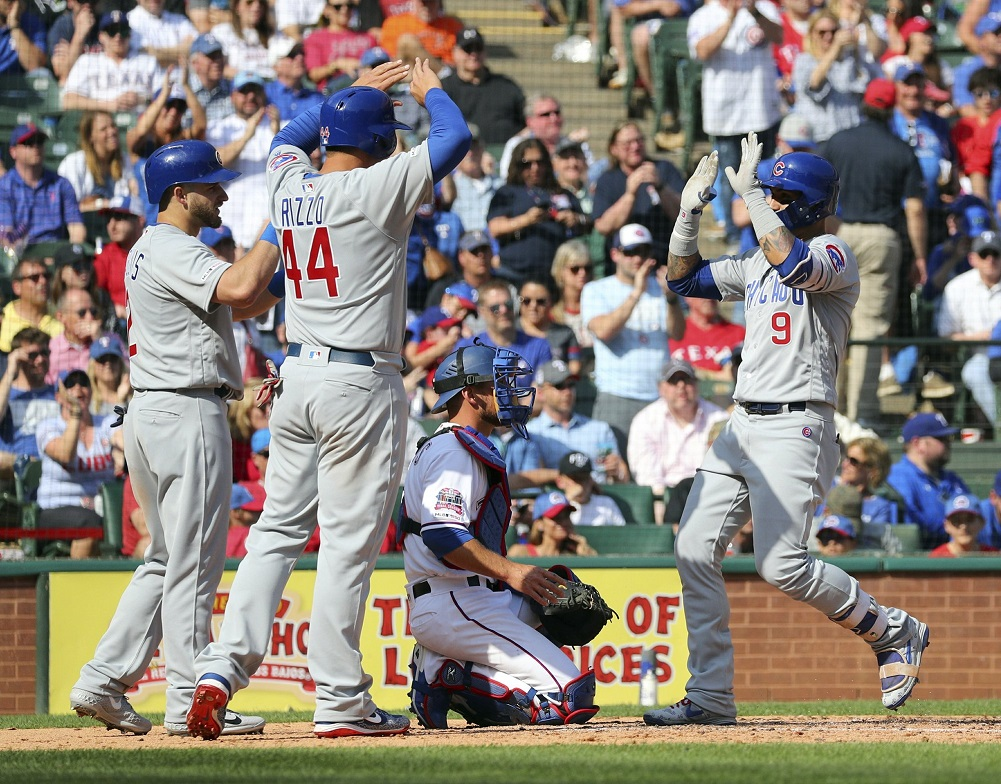 Baez hits 2 HRs as Cubs open season with win at Rangers