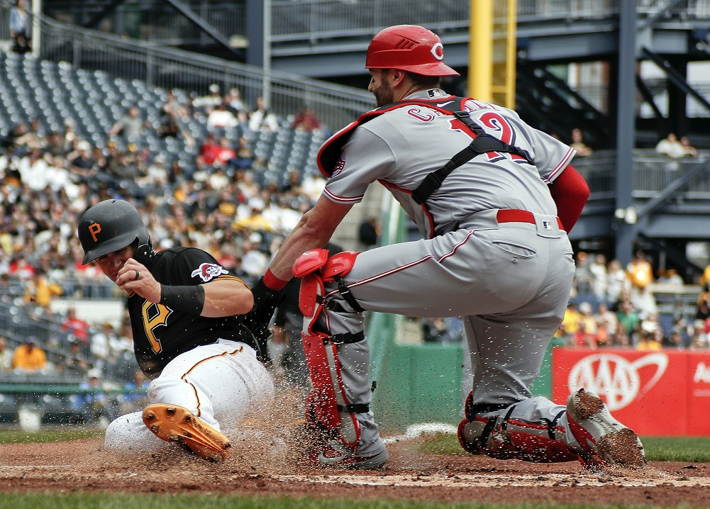 Newman doubles in 10th, Pirates beat Reds