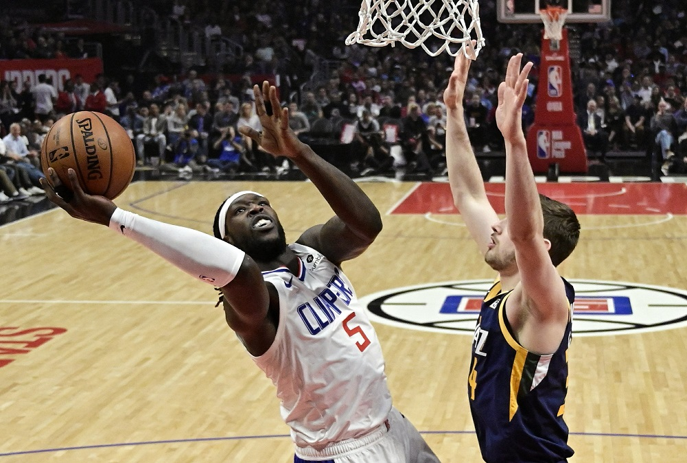 Clippers beat Jazz in OT to stop 3-game skid