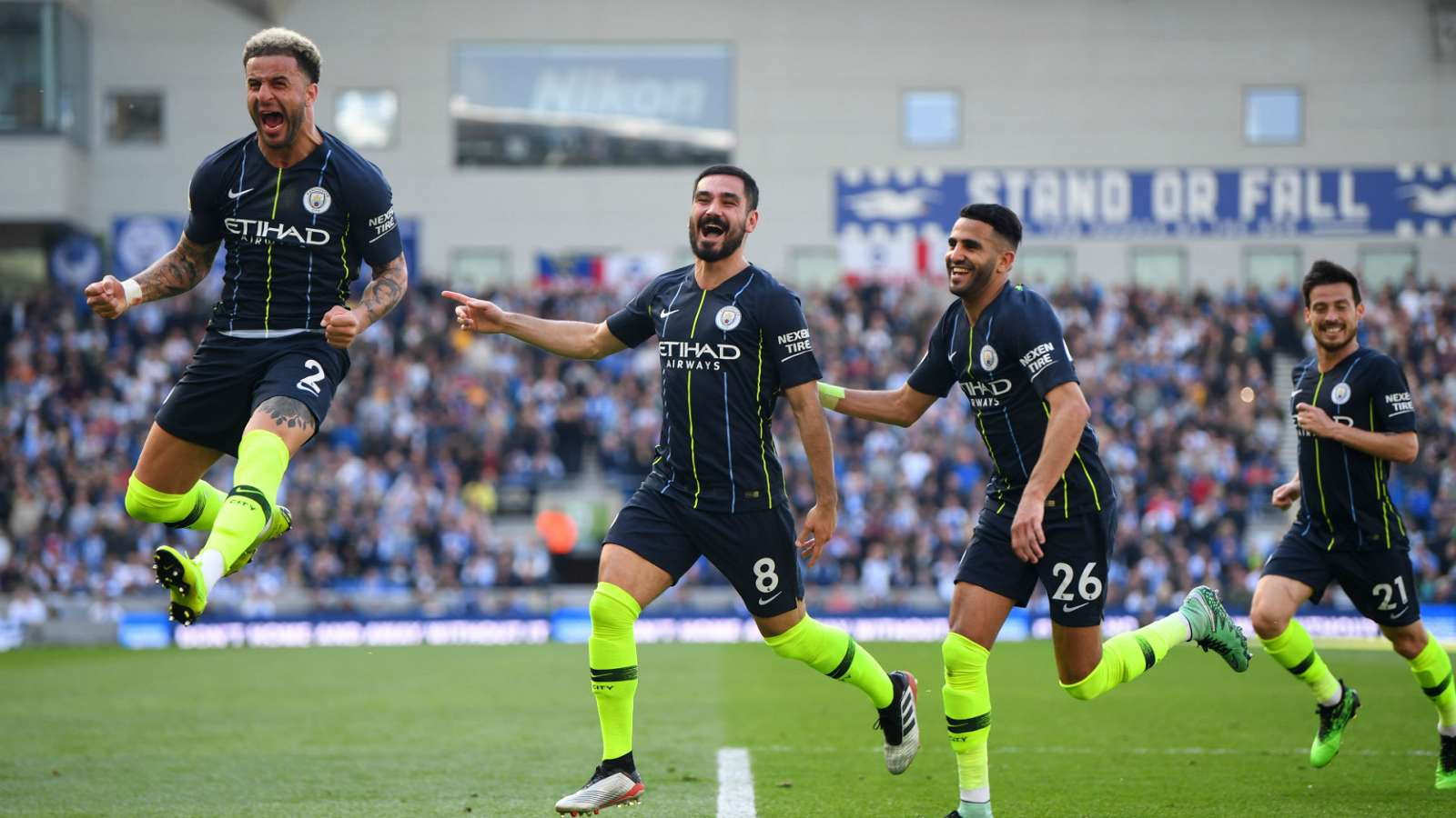 Guardiola's men storm to back-to-back titles