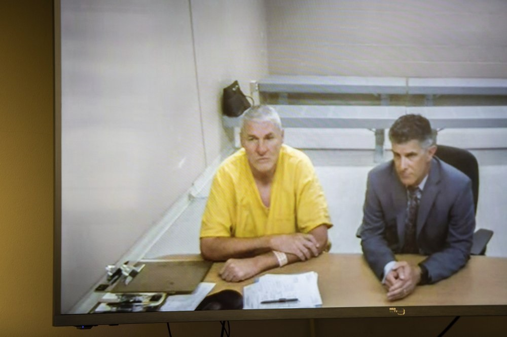 Police report: Ex-NFL star Mark Rypien says he hit wife