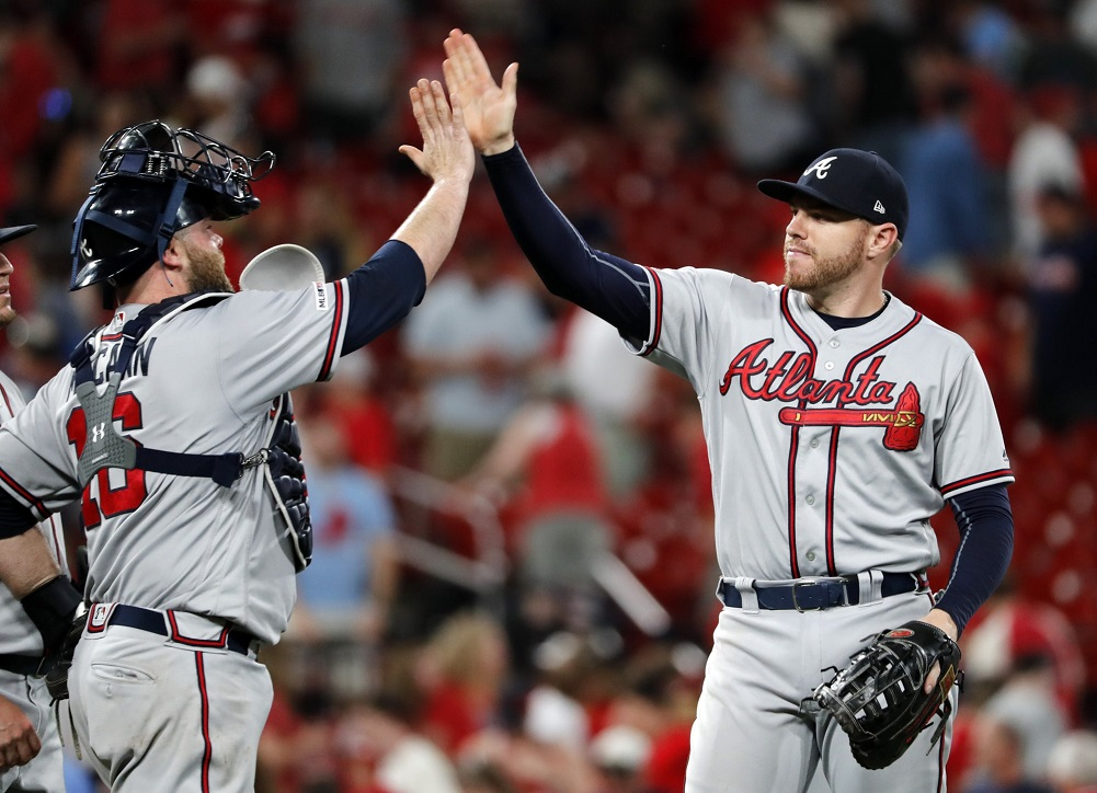 McCann's bases-loaded walk lifts Braves past Cardinals in 10