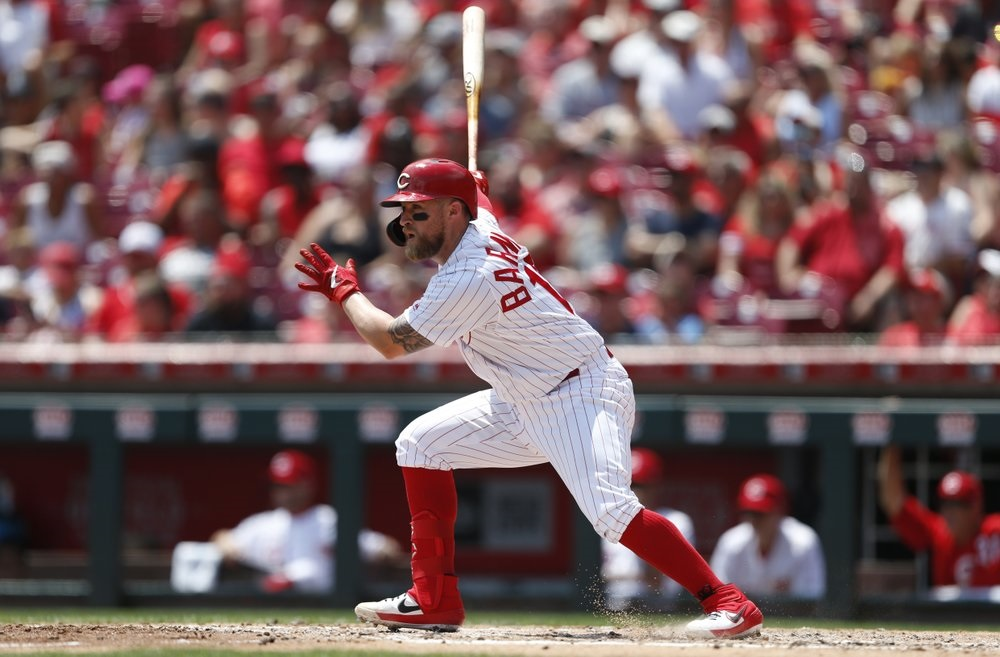 Barnhart RBI single leads Reds to win over Rockies