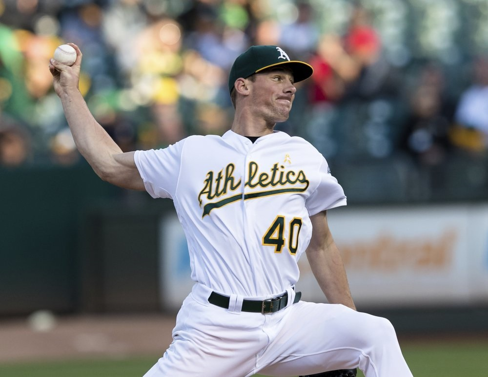 Bassitt fans 11, A's hit three HRs in win over Tigers