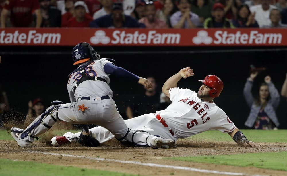 Pujols' 3 hits, 3 RBIs power streaking Halos past Astros