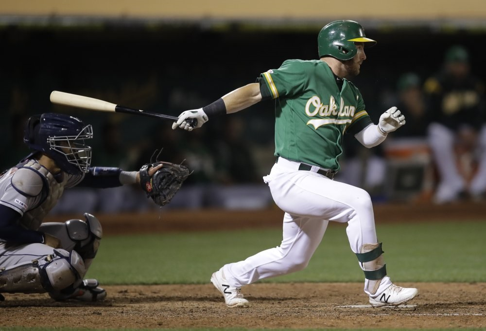 A's edge Astros in 13 to inch closer in playoff chase