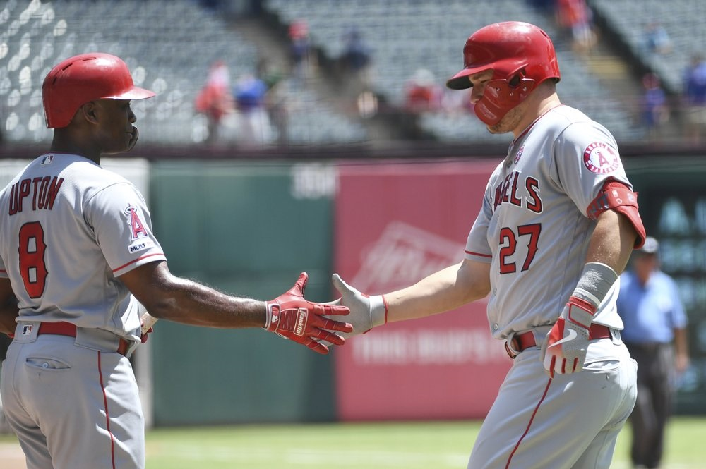 Trout, Heaney with career highs in Angels' win at Texas