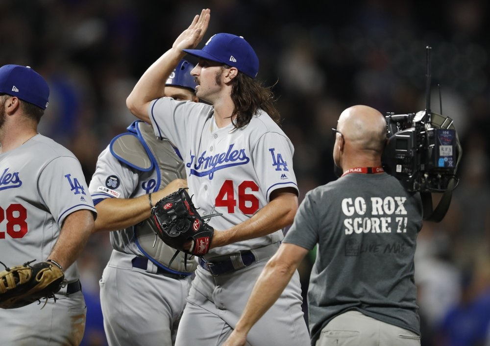 Gonsolin gets 4 inning save as Dodgers beat Rockies