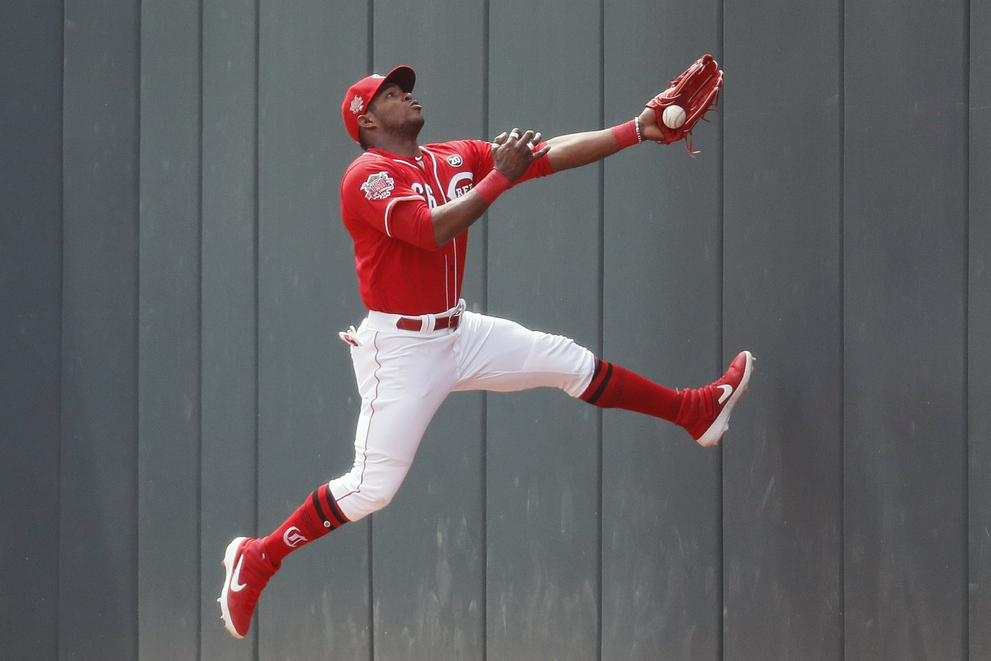 Puig returns with RBI double, Reds sweep Marlins