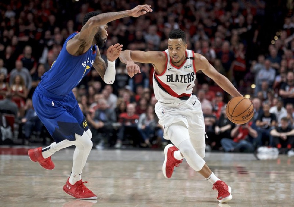 G CJ McCollum agrees to 3-year extension with Trail Blazers