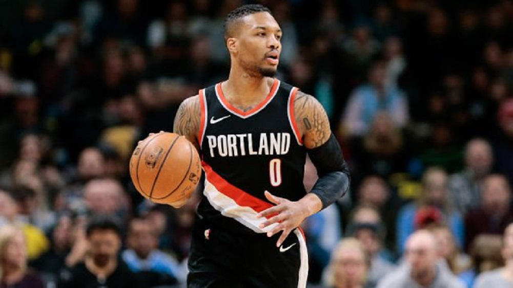 Lillard says he has separated ribs, will play through pain