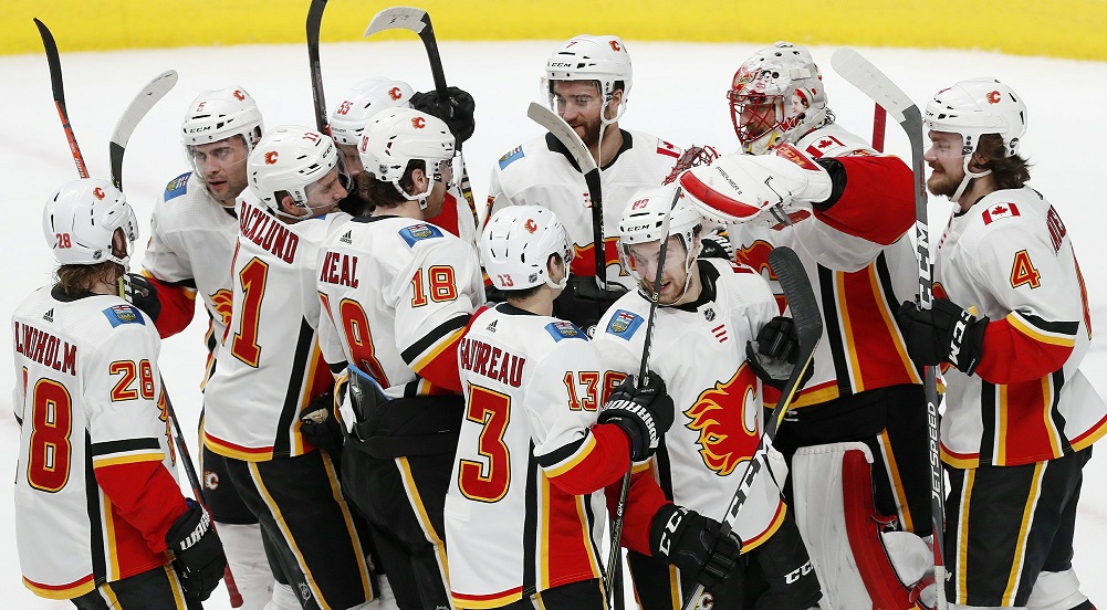 Flames top Sharks, clinch conference, division crowns