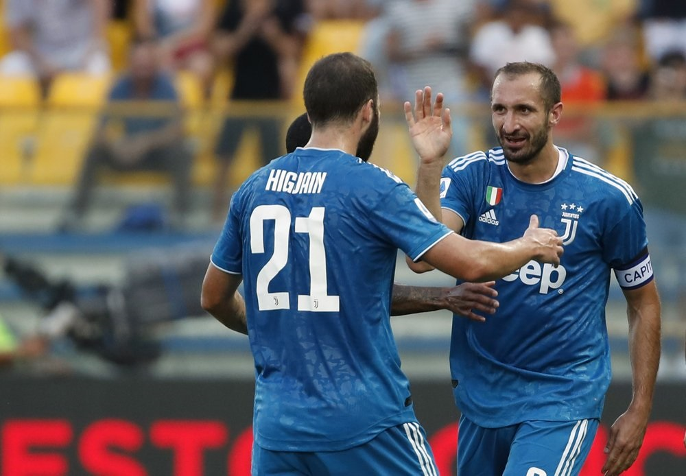 Juventus opens Serie A with win at Parma