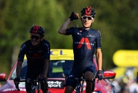 Tour de France - Stage 18 - Meribel to La Roche-sur-Foron - France - September 17, 2020. Team INEOS Grenadiers riders Richard Carapaz of Ecuador and Michal Kwiatkowski of Poland celebrate as they cross the finish line.