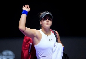 WTA Tour Finals - Shenzhen Bay Sports Center - Shenzhen, Guangdong province, China - October 30, 2019 Canada's Bianca Andreescu waves after retiring injured from her match against Czech Republic's Karolina Pliskova