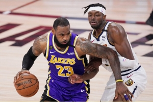 Los Angeles Lakers' LeBron James (23) drives against Denver Nuggets' Jerami Grant during the second half of an NBA conference final playoff basketball game Saturday, Sept. 26, 2020, in Lake Buena Vista, Fla.