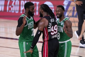 Boston Celtics' Jaylen Brown, left, and Miami Heat's Jae Crowder (99) exchange words as Kemba Walker (8) attempts to calm the situation during the second half of an NBA conference final playoff basketball game, Saturday, Sept. 19, 2020, in Lake Buena Vista, Fla.