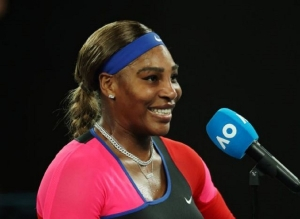 Serena comes through Halep test to reach semi-finals