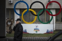 In this Nov. 28, 2019 file photo Olympic Rings and a model of Misha the Bear Cub, the mascot of the Moscow 1980 Olympic Games, left, are seen in the yard of Russian Olympic Committee building in Moscow, Russia. Russia's status as an Olympic team and reputation as a serial cheater in international sports goes on trial next week, in the latest legal fallout from state-backed doping dating back several years. The Court of Arbitration for Sport judges will start on Monday Nov. 2, 2020, hearing evidence about a manipulated database from the Moscow testing laboratory.