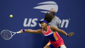 Naomi Osaka, of Japan, returns a shot to Jennifer Brady, of the United States, during a semifinal match of the US Open tennis championships, Thursday, Sept. 10, 2020, in New York.