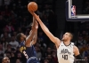 Jokic helps Nuggets hold on for win over Clippers
