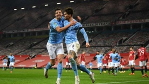 Manchester United v Manchester City: Stones ends goal drought as holders reach another final