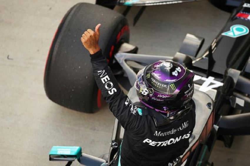 Russian Grand Prix - Sochi Autodrom, Sochi, Russia - September 26, 2020 Mercedes' Lewis Hamilton celebrates qualifying in pole position.