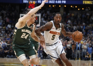 Murray scores 21 as Nuggets beat short-handed Bucks