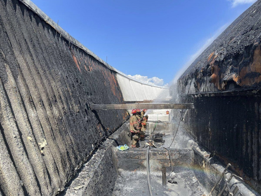 New Orleans: Flames shoot up side of Superdome roof, put out