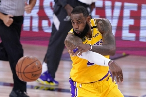 Los Angeles Lakers forward LeBron Jame makes a pass during the second half an NBA conference final playoff basketball game against the Denver Nuggets on Friday, Sept. 18, 2020, in Lake Buena Vista, Fla.