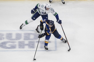Vancouver Canucks' Tyler Myers (57) chases St. Louis Blues' Vladimir Tarasenko (91) during the second period in Game 1 of an NHL hockey Stanley Cup first-round playoff series, Wednesday, Aug. 12, 2020, in Edmonton, Alberta.