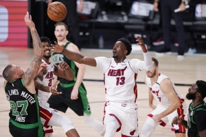 Miami Heat's Bam Adebayo (13) and Boston Celtics' Daniel Theis (27) battle for the ball during the second half of an NBA conference final playoff basketball game Friday, Sept. 25, 2020, in Lake Buena Vista, Fla.
