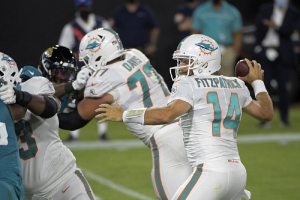 Miami Dolphins quarterback Ryan Fitzpatrick (14) throws a touchdown pass against the Jacksonville Jaguars during the first half of an NFL football game, Thursday, Sept. 24, 2020, in Jacksonville, Fla.